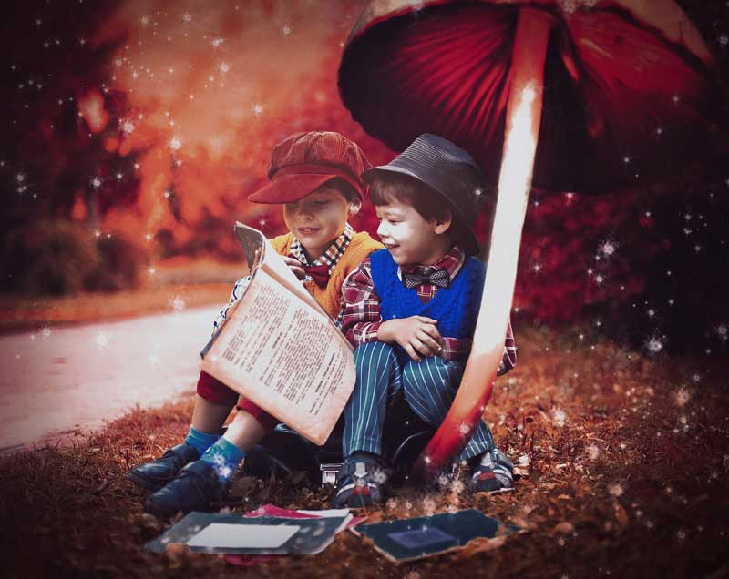 A fantasy image of two boys sitting under a red muchroom reading books, with an autumn scene by a street in the background. This image shows the joy gained from storytelling and how memorable this is. In marketing, the concept is no different in branding.