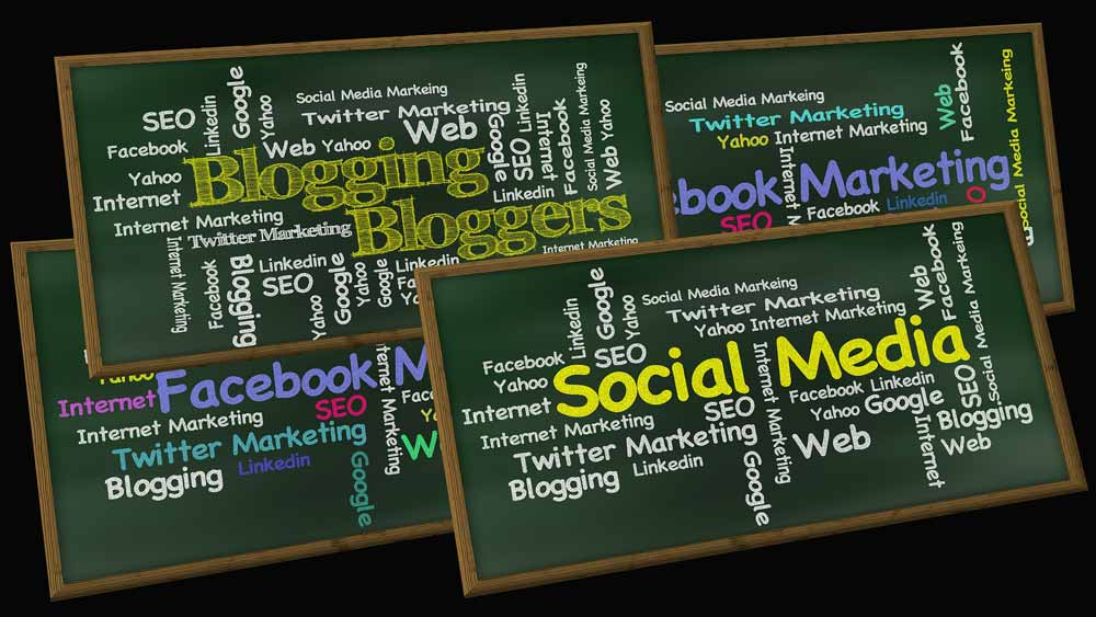 Four small blackboards with words important to social media and digital marketing.